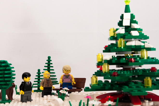 Dale's colleagues had gathered on the snow below. Harold, Marcus and Tina were singing carols as they stood in front of a giant Christmas tree. Dale's eyebrow rose in curiosity.