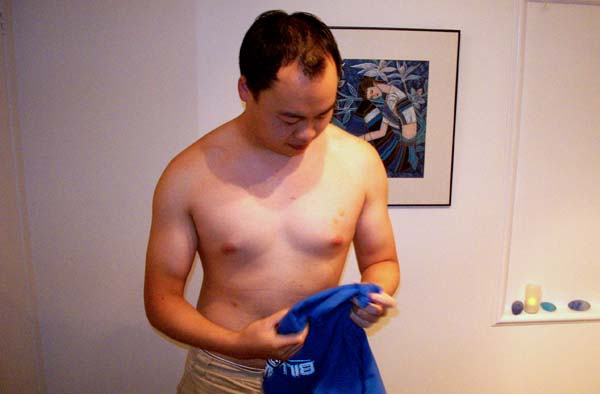Chow prepares for his waxing with Elise. He claims the bruise on his left breast was from an errant nipple cripple.