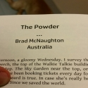 The start of a short story by Brad Mcnaughton, in a book, with a dog's butt in the background.