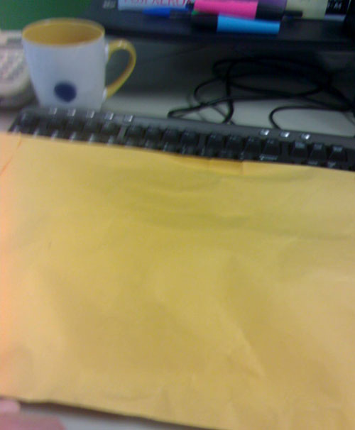 But what's this in the internal mail? A blurry envelope from Chow? What could be inside? More LEGO?!