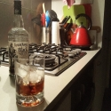 A glass of not champagne on a benchtop.